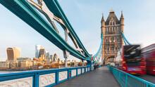 UK, England, London, Blurred Motion OfÔøΩdouble-deckerÔøΩbus Driving Across Tower Bridge At Dawn