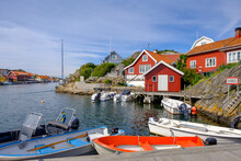 Sweden, Vastra Gotaland County, Kyrkesund, Motorboats Moored In Fishing Village