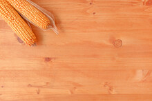 Two Corncobs On Rustic Wooden Background, Top View