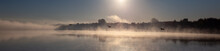Panorama Of The River In The Morning Fog. A Seagull Flying Over The River