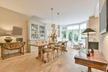 Modern Dining Room Interior With Wooden Furniture On Parquet