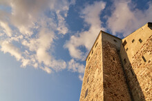 Turku Castle Against Blue Sky With White Clouds.
