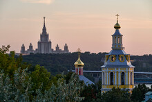 Russia. Moscow At Sunset. The Main Building Of Moscow State University, The Church Of The Ascension And The Church Of St. John The Theologian In The Andreevsky Monastery