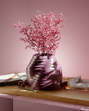Layered Purple Vase On A Contemporary Desk With Cherry Blossoms