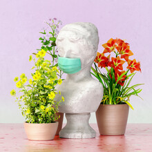 Marble Greek Bust With Disposable Mask And Blooming Flowers
