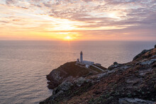 South Stack Lighthouse During A Beautiful Sunset In Wales, The UK