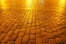 Golden Hue At Night On Empty Cobbled Street
