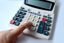 Closeup Keys And Display Of The Calculator, Female Hand Presses The Buttons Of The Stationary Cash Register, Counts And Calculates Counting Operations, Small Family Business Concept