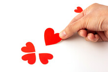 Hand Holding Heart Shaped Red Paper Isolated On A White Background, Concept Love And Valentine's Day.
