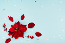 Christmas Holiday Card - Xmas Red Flower Poinsettia, Silver Snowflakes, Acorns On Blue Paper Background.