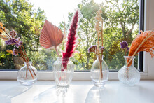 Decorative Vases And Flowers With Interior Decor Concept On Window Sill,Still Life Beautiful Vase With Dried Flowers . The Concept Of Comfort And Home Decor. Close Up. Modern Style In The Interior