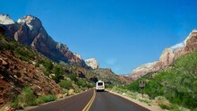 Zion National Park In Utah, United States. This Road Is Closed To General Vehicles And A Free Shuttle Bus Will Take Tourists Ahead.