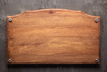Nameplate Or Sign Board At Wooden Background. Front View Of Name Plate