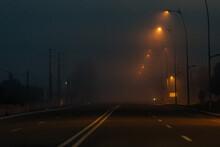 Empty Dark Road In Foggy Weather