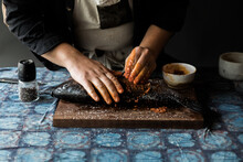 Male Chef Seasoning Whole Fish