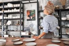 Craftswoman Taking Break In Pottery
