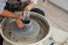 Crop Female Making Pot From Clay