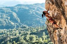 Mature Sportswoman Rock Climbing