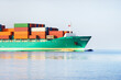 Leinwandbild Motiv Large cargo container ship sailing in an open sea. Concept seascape. Freight transportation, global communications, industry, economy, commerce, logistics