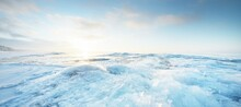 Panoramic View Of The Snow-covered Shore Of The Frozen Baltic Sea At Sunset. Ice Fragments Close-up. Colorful Cloudscape, Soft Sunlight. Symmetry Reflections On The Water. Christmas, Seasons, Winter