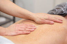 Hands Of Massagist Are Scrubbing Woman's Back