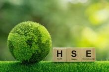 Concept Of HSE Health Safety Environment Education Industry.words HSE On A Woodblock It Is An Idea For Health Safety Environment For Business And Organization.