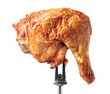 Leinwandbild Motiv Grilled chicken leg on a fork.