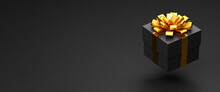 A Dark Present Box With Golden Ribbon And Bow Hovering Over A Black Stone Background. Copy Space - Web Banner Size