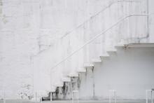 White Staircase On A Dirty Building Facade
