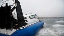 The Hovercraft Is Ready For A Ride On The Frozen Icy Surface Of The Lake