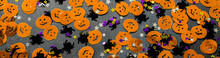 Banner Halloween Background: Confetti In The Shape Of Orange Pumpkins, Black Spiders And Stars. Copy Space