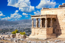 Ancient Erechtheion Or Erechtheum Temple With Caryatid Porch On The Acropolis, Athens, Greece. World Famous Landmark At The Acropolis Hill.