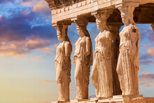 Detail Of Caryatid Porch On The Acropolis Uring Colorful Sunset In Athens, Greece. Ancient Erechtheion Or Erechtheum Temple. World Famous Landmark At The Acropolis Hill.