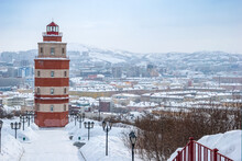 Murmansk City In Winter. Lighthouse - A Memorial To Sailors Who Died In Peacetime. Kola Peninsula.