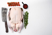Fresh Raw Whole Duck Ready For Cooking With Herbs, On White Stone Table Background, Top View Flat Lay , With Copy Space For Text