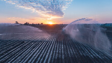 Water Sprinklers On A Ploughed Field Near Gin Gin, Queensland