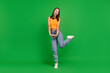 Leinwandbild Motiv Full body photo of happy young positive woman lovely lady hands together good mood isolated on green color background