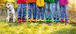 Leinwandbild Motiv Colorful kids shoes. Children play outdoor.