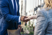 Anonymous Young Diverse Business Partners Shaking Hands