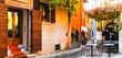 Leinwanddruck Bild - Charming old narrown streets of Italian villages. Malcesine, Garda lake, Italy. Autumn colors urban scenery