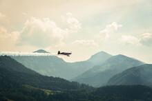 Airshow In St. Wolfgang Im Salzkammergut Over Wolfgangsee Lake With The Mountains In The Background, Austria