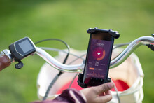 POV Woman On Bicycle Checking Heart Rate With Smart Phone App