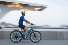 Man Riding Illuminated Bicycle In City
