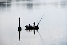 Silhouette Of Fishing Rubber Dinghy And Fishermen