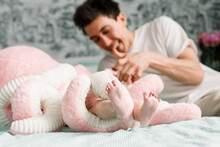 Happy Father Playing With A Baby In Octopus