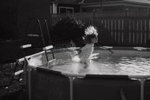 Monochromatic Photo Girl Leaping Into Backyard Pool