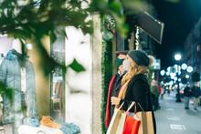 Stylish Couple Enjoying Christmas Sales
