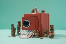 Dollar Bills And Coins With The Red Safe