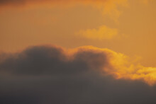 Vibrant Orange Sunset With Clouds