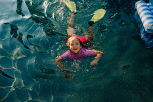 Girl With Fins Swimming In Pool